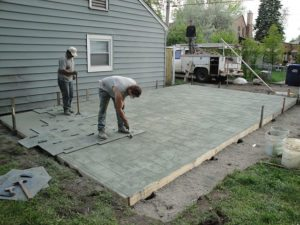 Concrete being stamped