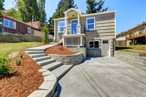 Sunrise house exterior with concrete walkway